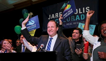 U.S. Rep Jared Polis waves to the crowd while accepting the Democratic nomination for the Colorado Governor's race at an election night rally, Tuesday, June 26, 2018, in Broomfield, Colo.