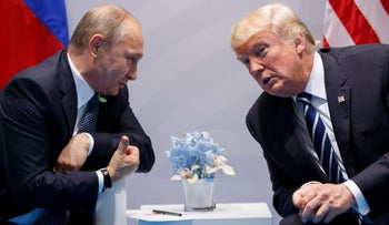 In this file photo taken on Friday, July 7, 2017, U.S. President Donald Trump meets with Russian President Vladimir Putin at the G-20 Summit in Hamburg, Germany.