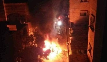 The car, allegedly carrying a Hamas operative prepping flaming kites, struck by Israeli forces, June 27, 2018.