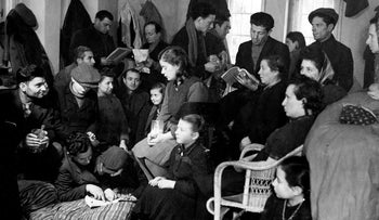 Polish Jewish refugees are camped out in a smoky room where they also eat and sleep, in the American zone of Berlin, Jan. 31, 1946.