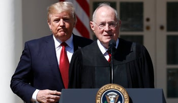 In this April 10, 2017, file photo, President Donald Trump, left, and Supreme Court Justice Anthony Kennedy participate in a public swearing-in ceremony for Justice Neil Gorsuch in the Rose Garden of the White House White House in Washington.