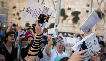 Female activists praying at the Western Wall.