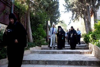 Prince William descending the stairs toward the crypt at the Church of Mary Magdelene in Jerusalem, June 28, 2018.