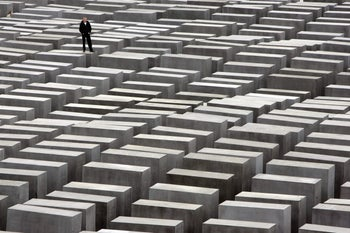 A youth stands on one of the charcoal-coloured concrete slabs of the Holocaust memorial in Berlin, May 12, 2005