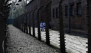 """Participants at the annual """"March of the Living"""" at the memorial site of the Auschwitz-Birkenau Nazi death camp in Oswiecim, Poland. April 12, 2018"""