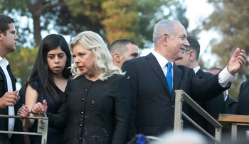 Benjamin and Sara Netanyahu attend a reception for Prince William at the home of the British ambassador in  Ramat Gan, Israel.