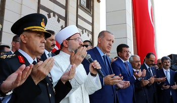 Turkish President Recep Tayyip Erdogan and officials at an opening ceremony for a mosque at a military school in Ankara, June 29, 2018.