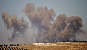 Smoke rises above opposition held areas of the Daraa province countryside during airstrikes by Syrian regime forces on June 27, 2018
