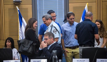 The Justice Ministry's Keren Bar-Menachem, standing at left, and Police Commissioner Roni Alsheich at the Knesset, June 27, 2018.