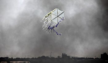 A kite flies over the border in an area where kites and balloons have caused blazes, between Israel and the Gaza strip, June 8, 2018