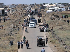 Internally displaced people from Daraa province arriving near Quneitra, Syria, close to the Israeli Golan Heights, June 29, 2018.
