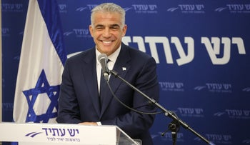 Yair Lapid at a faction meeting in March.
