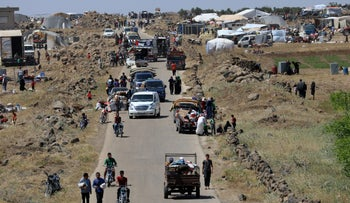 Internally displaced people from Deraa province arrive near the Israeli-occupied Golan Heights in Quneitra, Syria June 29, 2018