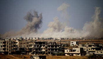 Smoke rises above rebel-held areas of the city of Daraa during airstrikes by Syrian regime forces on June 30, 2018