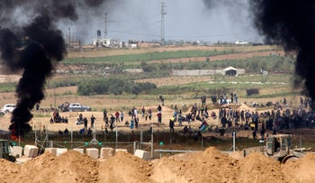 Heeding a call from Hamas, Palestinian residents of the Gaza Strip approach the border with Israel to protest the humanitarian crisis in Gaza, June 4, 2018.