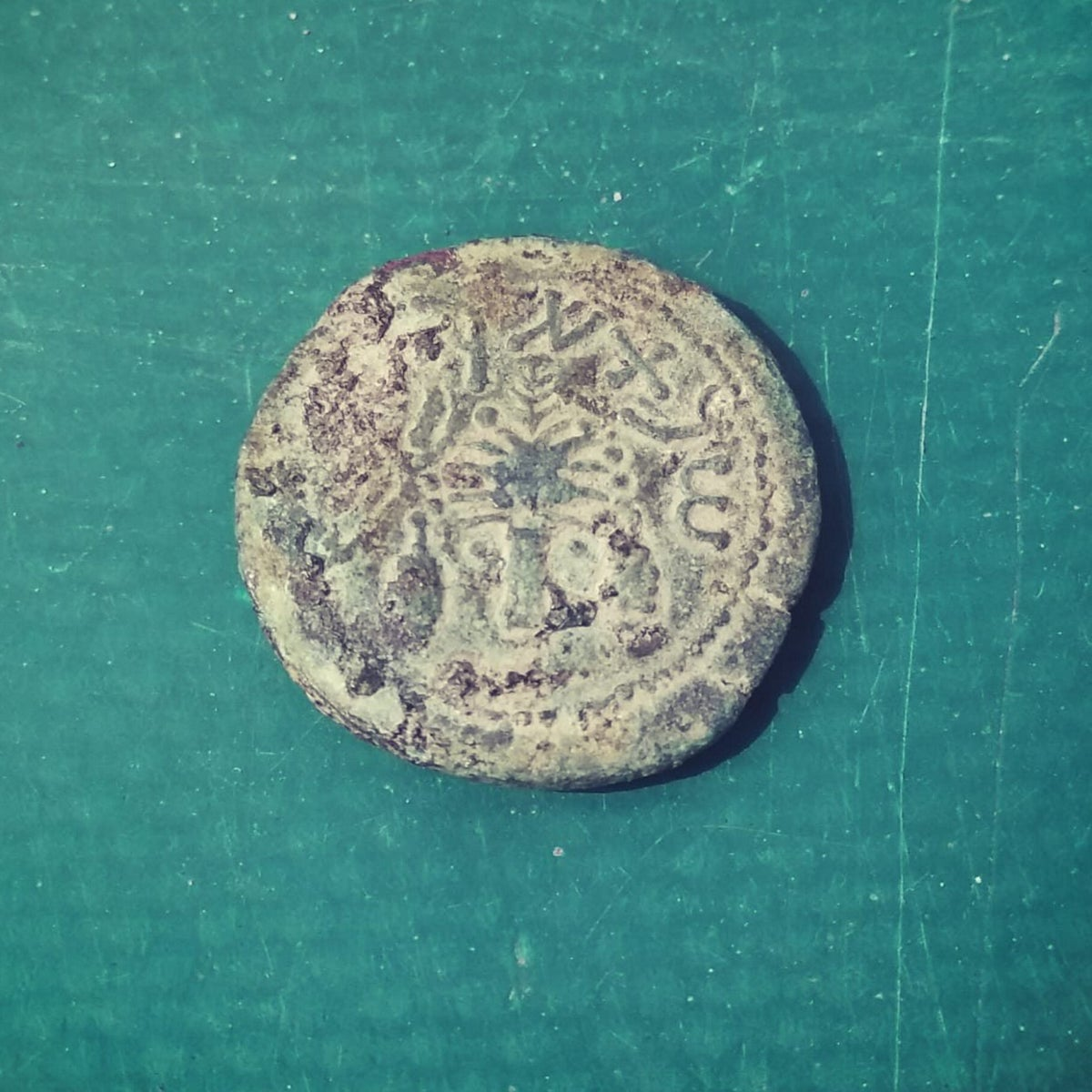 Coin minted in the year 69, found in ancient Jerusalem drainage tunnel