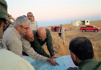 Iran's army chief of staff Maj. Gen. Mohammad Bagheri, left, with senior officers from the Iranian military as they visit a front line in the northern province of Aleppo, Syria. Oct. 20, 2017