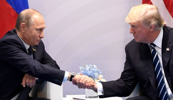US President Donald Trump and Russia's President Vladimir Putin shake hands during a meeting on the sidelines of the G20 Summit in Hamburg, Germany. July 7, 2017