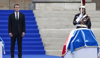 French President Emmanuel Macron holds a moment of silence as he pays his respects by the coffin of former French politician and Holocaust survivor Simone Veil during the burial ceremony at the Pantheon in Paris, July 1, 2018.