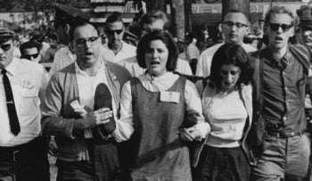 "Rabbi Arthur Waskow, carrying shoes, at a ""walk-in"" protest in Baltimore, Maryland, in 1963 to demonstrate against a segregated swimming pool. It was his first arrest for civil protest."