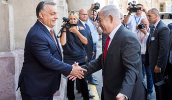 Hungarian Prime Minister Viktor Orban, left, shake hands with Israel's Prime Minister Benjamin Netanyahu prior to meeting of Netanyahu and the Visegrad Group's (V4) Prime Ministers in the Pesti Vigado building in Budapest, Hungary, Wednesday, July 19, 2017.