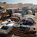 Syrian refugees gather in their vehicles getting ready to cross into Syria from the eastern Lebanese border town of Arsal, Lebanon, June 28, 2018.
