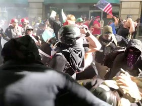 Protesters of the right-wing group Patriot Prayer clash with protesters from anti-fascist groups during a demonstration in Portland, Oregon, U.S. June 30, 2018