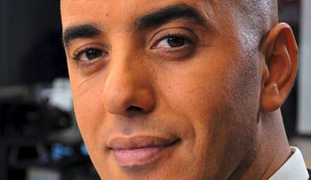 In this photo dated Nov. 22, 2010, notorious French criminal Redoine Faid poses prior to an interview with French all-news TV channel, LCI, as he was promoting his book, in Boulogne-Billancourt, outside Paris, France