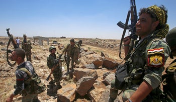 Syrian government forces' soldiers hold their weapons in the province of Daraa, on June 29, 2018.