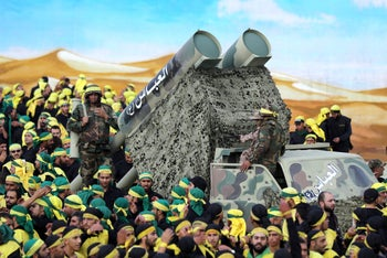Hezbollah members parade with a mock missile launcher in the Lebanese city of Nabatiyeh.