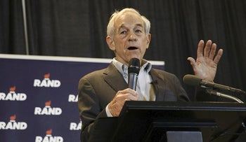 Ron Paul, former U.S. Representative from Texas, speaks before introducing his son, Senator Rand Paul, a Republican from Kentucky and 2016 presidential candidate, during a campaign event at the University of Iowa in Iowa City, Iowa, U.S., on Sunday, Jan. 31, 2016
