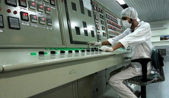 In this Feb. 3, 2007 file photo, an Iranian technician works at the Uranium Conversion Facility just outside the city of Isfahan 255 miles (410 kilometers) south of the capital Tehran, Iran
