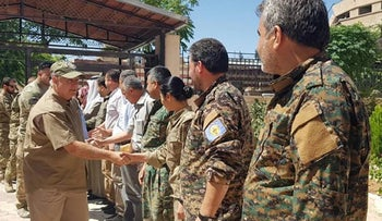 US Senator Lindsey Graham greeting members of the Manbij Military Council, which is affiliated with the Syrian Democratic Forces, during a visit to the northern Syrian town of Manbij, July 2, 2018