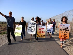 A group of protesters by the Israel-Gaza border wall, on July 3, 2018