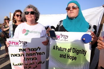 Dr. Julia Chaitin (left) and Ghadir Hani (right) protesting side by side, on July 3, 2018