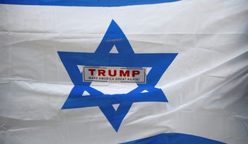 Counter-demonstrators hold an Israel flag with a Trump sticker at a pro-Palestinian rally in New York City, U.S., May 18, 2018.