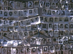 Pictures of those 'disappeared' by the military junta between 1976-1983 hanging in Plaza de Mayo, Buenos Aires, Argentina