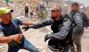Demonstrators scuffle with Israeli police in the Palestinian Bedouin village of Khan al-Ahmar, east of Jerusalem in the occupied West Bank on July 4, 2018