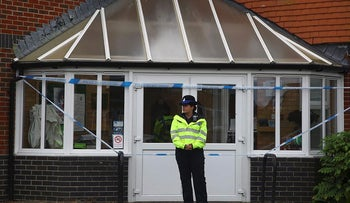Police officers are seen outside Amesbury Baptist Centre in Amesbury, nine miles north of Salisbury, southern England, on July 4, 2018