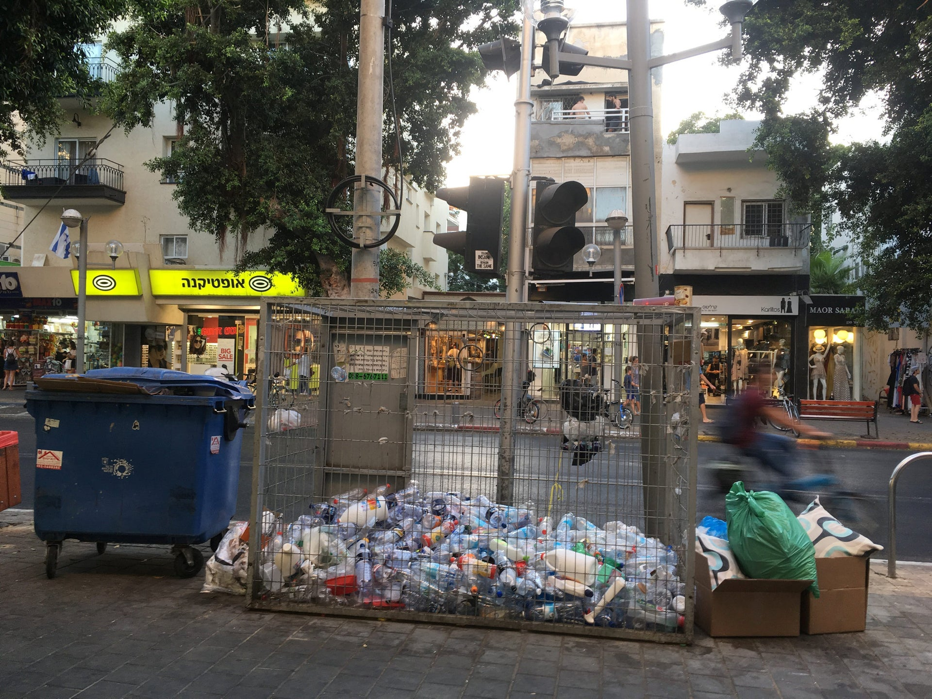 Recycling bottles and dumpsters in the center of Tel Aviv.