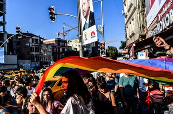 A LGBT rights activist carries a rainbow flag in rainbow colors in Istanbul, after Turkish authorities banned the annual Gay Pride Parade for a fourth year in a row. July 1, 2018