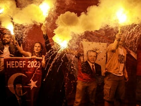 Supporters of Turkey's President and ruling AKP leader Recep Tayyip Erdogan light flares during celebrations outside the party headquarters in Istanbul. June 24, 2018