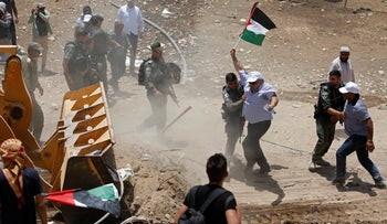 Palestinians protesting the planned demolition of Khan al-Ahmar, Wednesday, July 4, 2018