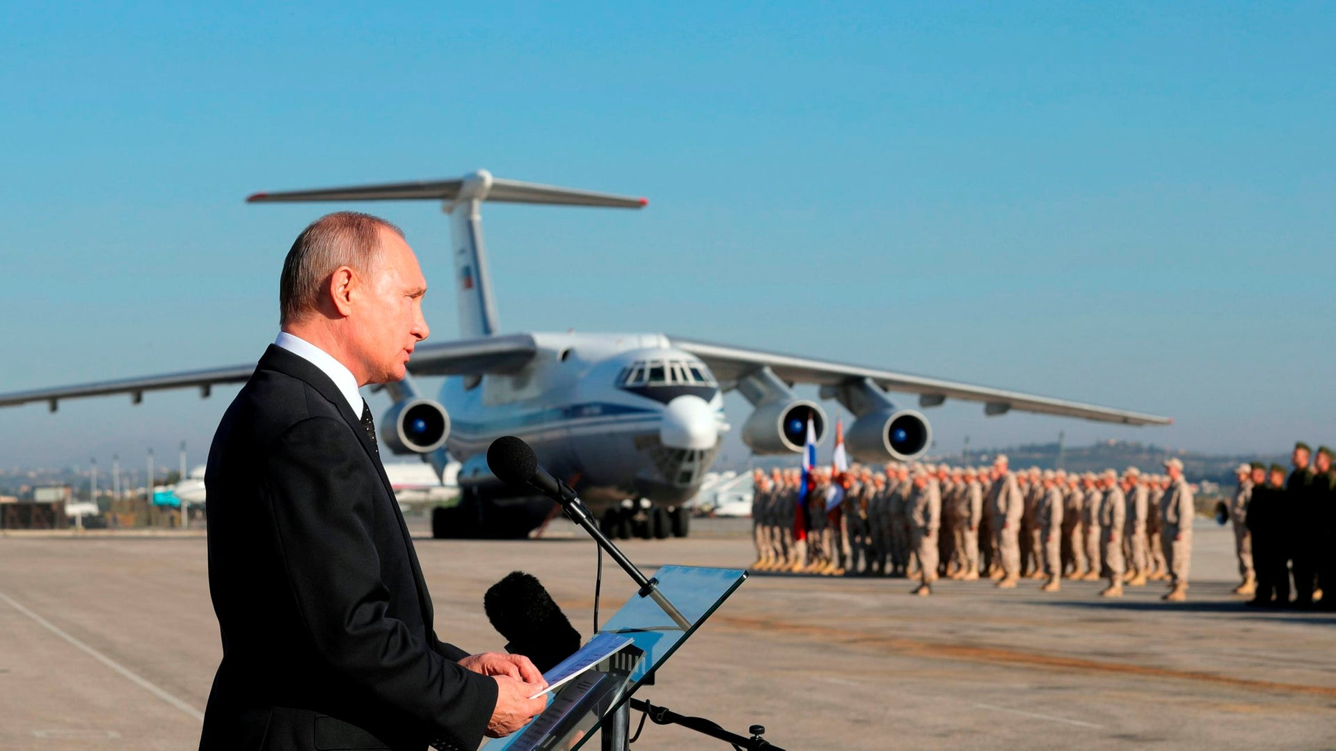 In this Dec. 12, 2017, file photo, Russian President Vladimir Putin addresses the troops at the Hemeimeem air base in Syria.