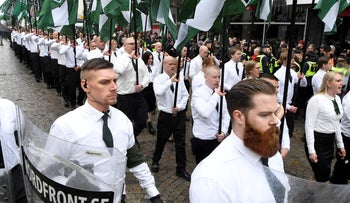 Members of the Neo-nazi Nordic Resistance Movement march through the town of Ludvika, Sweden May 1, 2018.