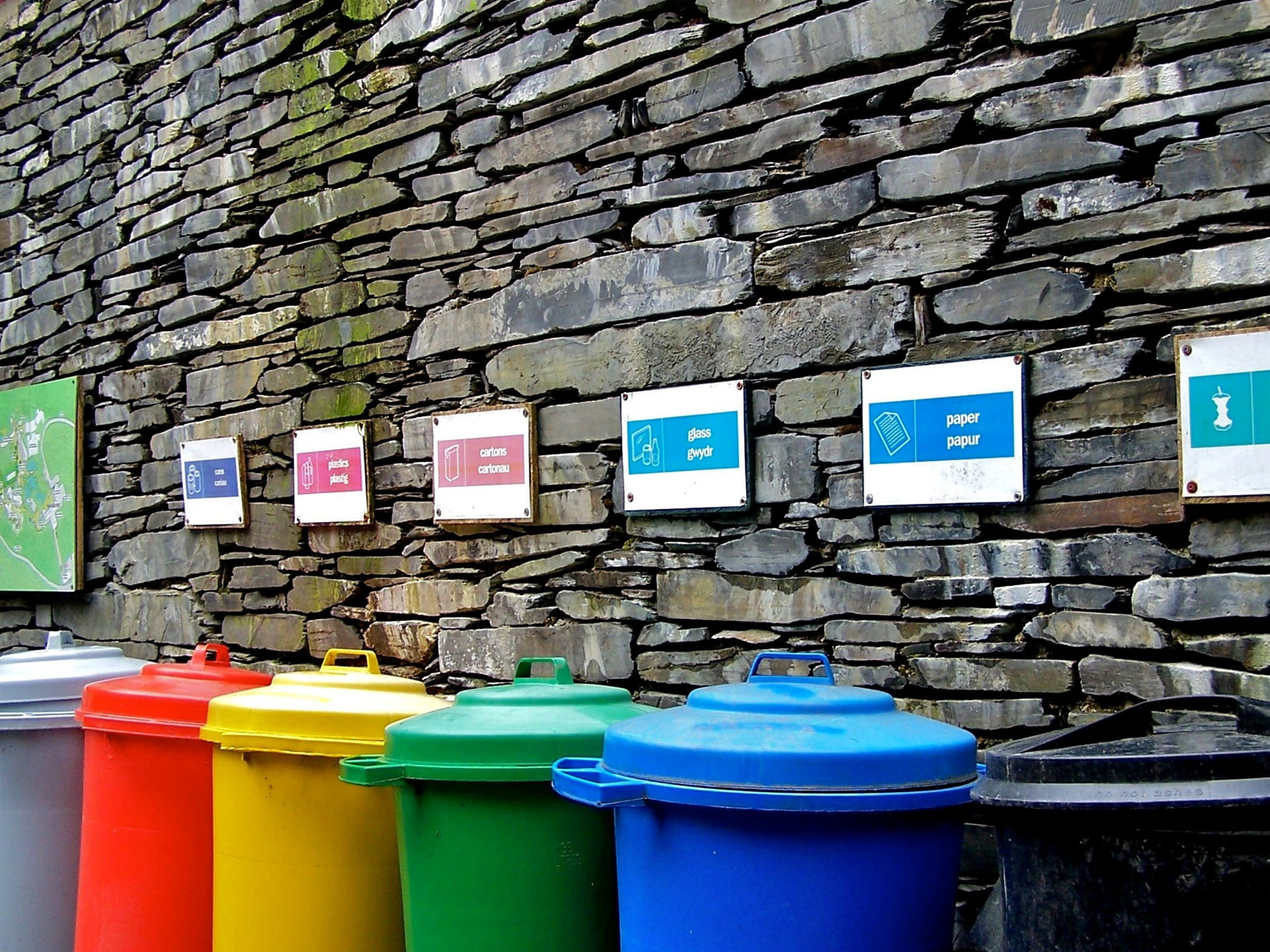 Colourful row of recycling plastic dustbins.