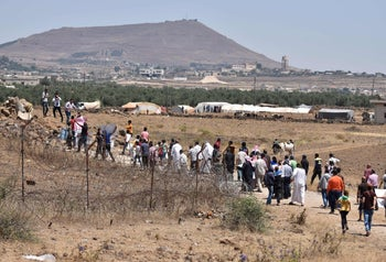 Displaced Syrians protest in front of a UN base in the Syrian Quneitra province near the border with the Israeli-occupied Golan Heights, demanding UN help. July 4, 2018.