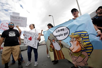 Demonstrators at a protest against U.S. President Donald Trump administration's immigration policies at the Paso del Norte border crossing bridge, Mexico, June 30, 2018.