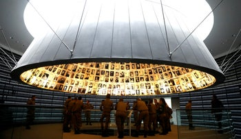 A group of Israeli soldiers visits the Hall of Names in the Holocaust History Museum at the Yad Vashem World Holocaust Remembrance Center in Jerusalem, April 10, 2018
