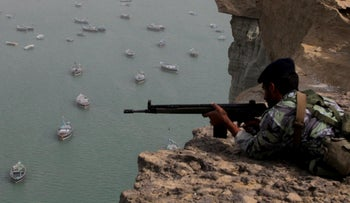 Iranian military personnel participate in the Velayat-90 war game in unknown location near the Strait of Hormuz in southern Iran December 30, 2011